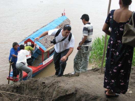 Climbing mud embankment to village