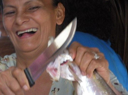 Pastora cutting fish