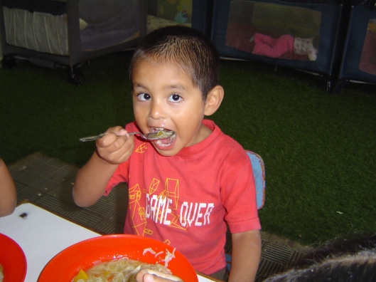Orphanage - boy eating_2