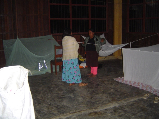 Sleeping area on concrete floor in village