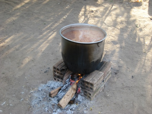 Pot cooking over fire