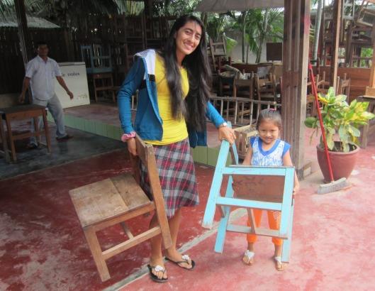 Nina and Angelina bringing chairs